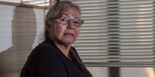 Sharon Acoose sitting in her office at the First Nations University of Canada in Saskatoon on Nov. 15,