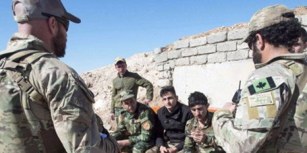 Canadian special forces soldiers speaking with Kurdish Peshmerga fighters in northern Iraq on Feb. 20,