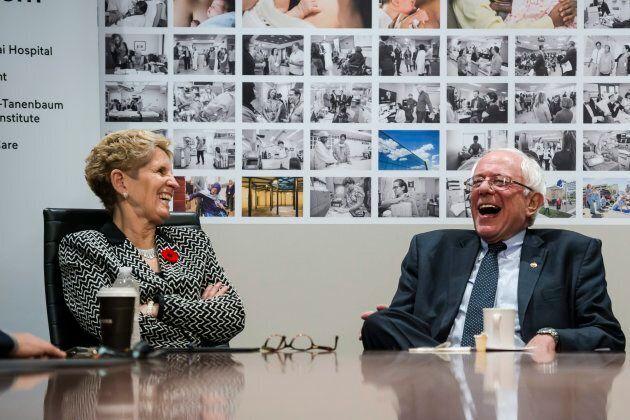U.S. Sen. Bernie Sanders and Ontario Premier Kathleen Wynne smile during a visit to Mount Sinai Hospital...
