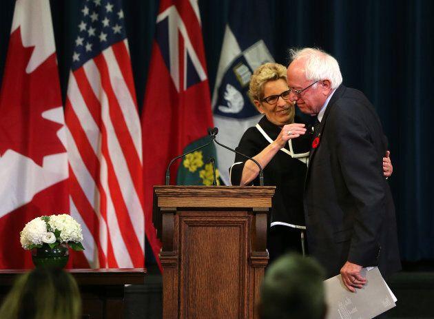 Ontario Premier Kathleen Wynne welcomes Senator Bernie Sanders at the University of Toronto on Oct. 29,