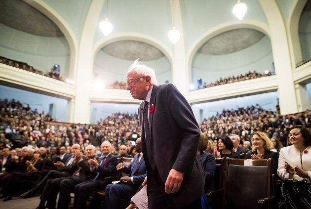 U.S. Senator Bernie Sanders gets up to speak at the University of Toronto on Oct. 29,