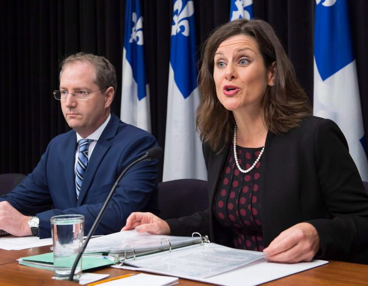 Quebec Justice Minister Stephanie Vallee provides further details about how the government's controversial Bill 62 will be implemented at the legislature, as Justice Minister Yan Paquette, left, looks on in Quebec City, Tuesday, Oct. 24, 2017.