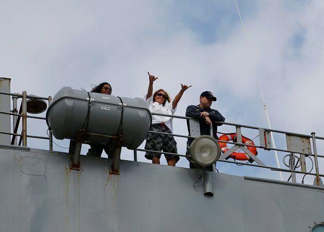 Jennifer Appel raises her arms from bridge way of the USS Ashland on Oct.