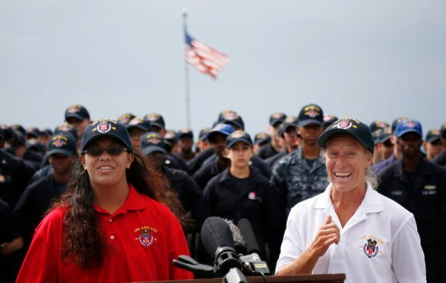 Jennifer Appel and Tasha Fuiava speak on the deck of the USS Ashland at White Beach Naval Facility in...