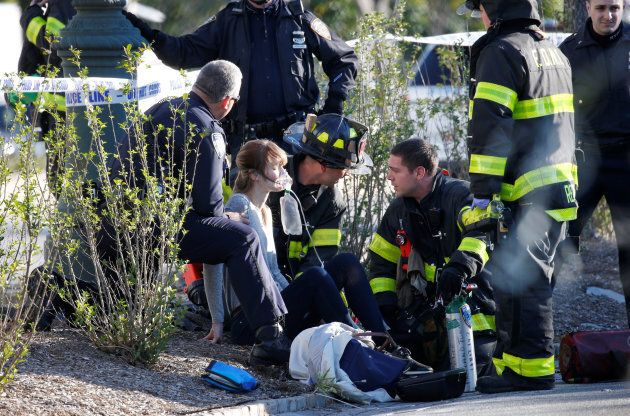 A woman is aided by first responders after sustaining injury on a bike path in lower Manhattan in New...
