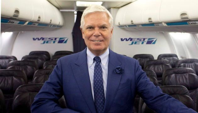 WestJet Airlines President & CEO Gregg Saretsky stands in the cabin of a Boeing 737 jet after the company's...