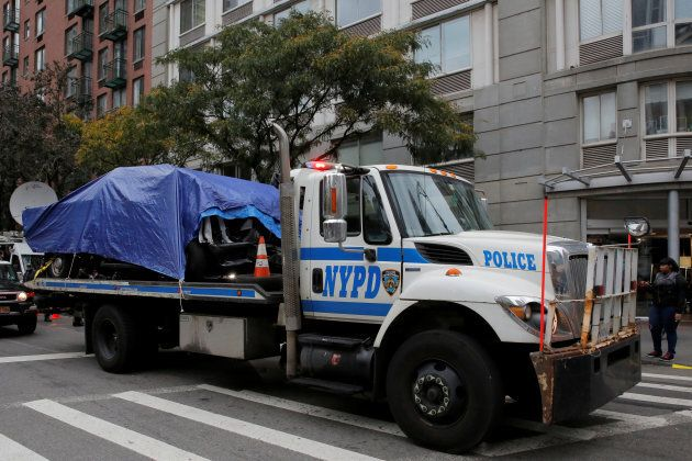 Police remove the pickup truck used in an attack on the West Side Highway in Manhattan, New York in