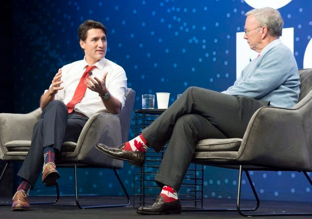 Prime Minister Justin Trudeau speaks with Alphabet executive chairman Eric Schmidt at the Google Go North...
