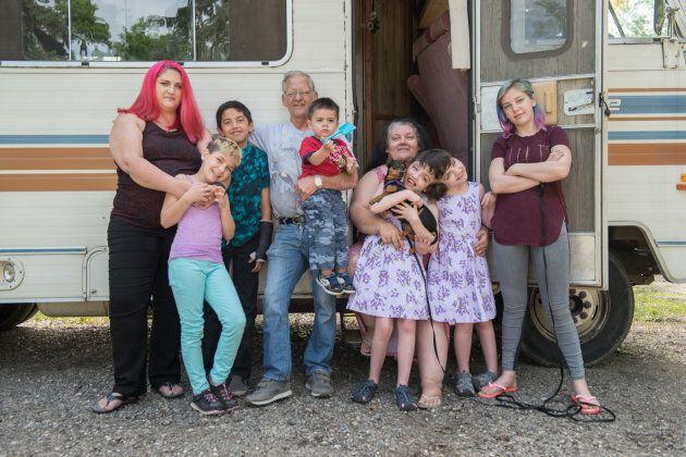 Tatiana and Krista Hogan pose for a photo with family.