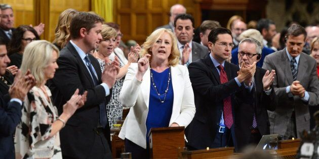 Conservative MP Lisa Raitt stands during question period in the House of Commons on Oct. 18,