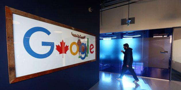 An employee walks in a hallway at Google Canada's engineering headquarters in Waterloo, Ont. on Jan....