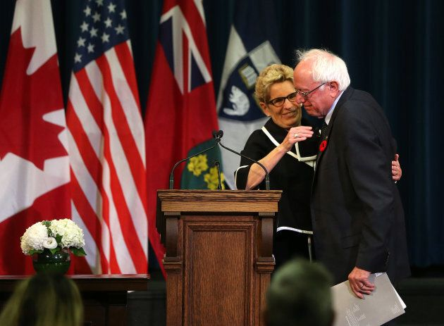 Ontario Premier Kathleen Wynne and American Senator Bernie Sanders talk about Canadian health care at the University of Toronto in Toronto, Ont. on Oct. 29, 2017.