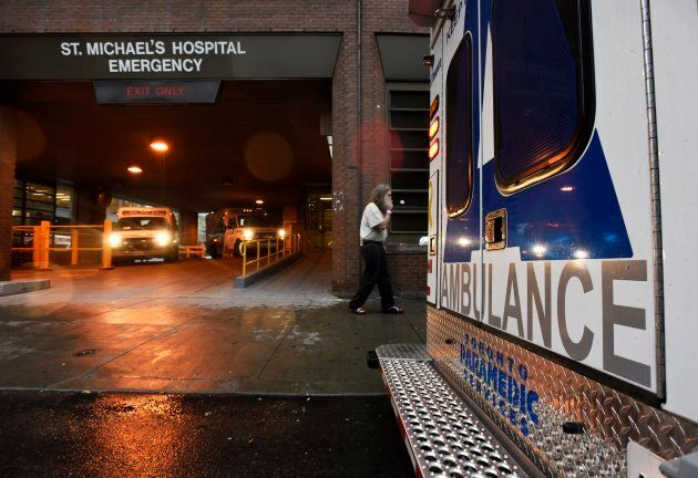 Ambulances drive through the emergency department at St. Michael's Hospital in Toronto on Oct. 20