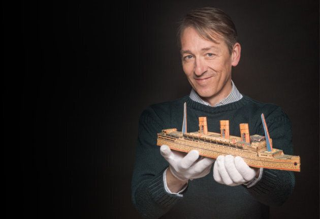 Roger Marsters, curator of marine history at Maritime Museum of the Atlantic in Halifax, holding a model