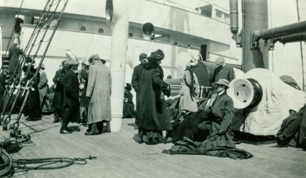 Survivors of the sinking of the Titanic rest aboard the RMS Carpathia, the ship that rescued them, on...