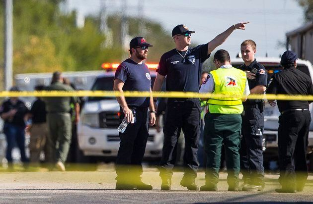 Law enforcement officials work the scene of a fatal shooting at the First Baptist Church in Sutherland...
