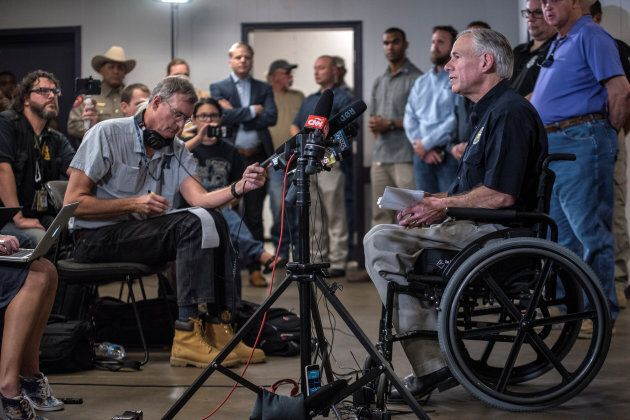 Texas Gov. Greg Abbott gives an update during a news conference at the Stockdale Community Center following...