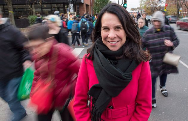 Valérie Plante stands on a Montreal street corner on