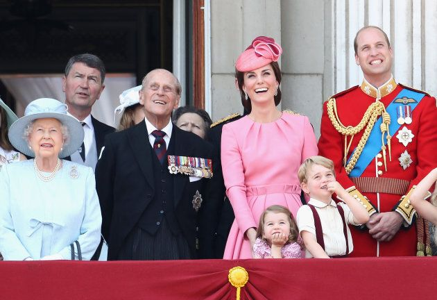 (L-R) Queen Elizabeth II, Prince Philip, Duchess of Cambridge, Princess Charlotte, Prince George and Prince William, Duke of Cambridge looking out at the Trooping the Colour parade in June 2017.