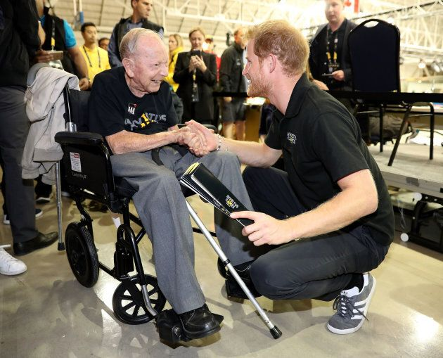 Prince Harry shakes hands with 101-year-old WW2 veteran Norm Baker on day six of the Invictus Games on Sept. 28, 2017 in Toronto.