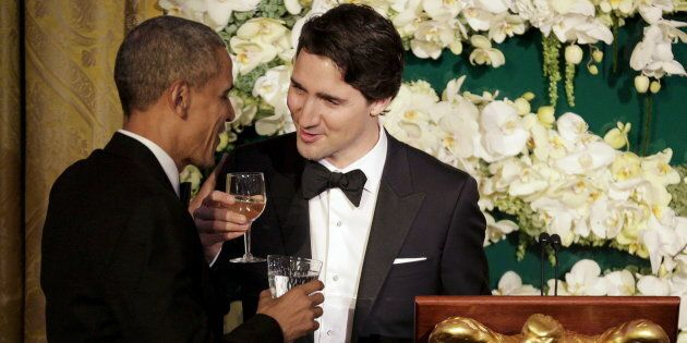 Prime Minister Justin Trudeau toasts former U.S. President Barack Obama during a state dinner at the...