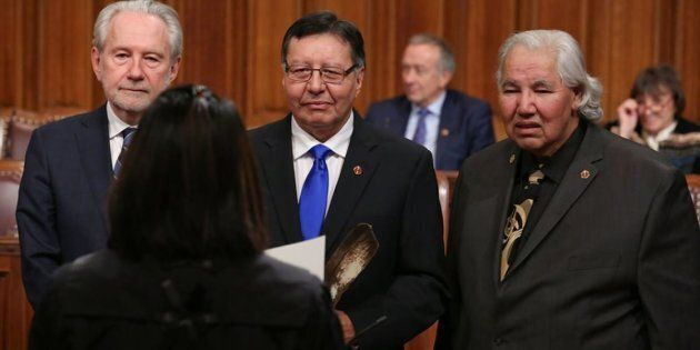 Sen. Daniel Christmas, centre, is pictured with Sen. Peter Harder (left) and Sen. Murray Sinclair