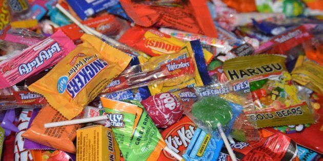 A large pile of mixed candy from trick or treating on Halloween night.