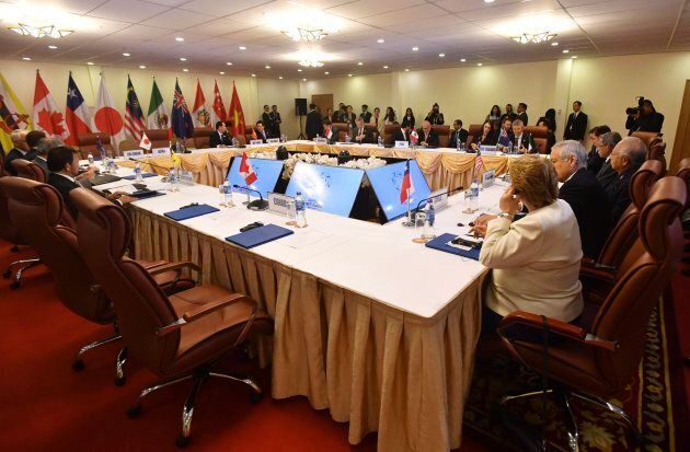 The empty seat, foreground, for Prime Minister Justin Trudeau is seen during a meeting of the Trans-Pacific...
