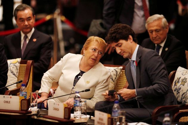 Prime Minister Justin Trudeau and Chile's President Michelle Bachelet talk at the APEC summit in Danang,...