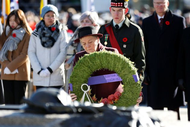 Silver Cross Mother Diana Abel lays a wreath during Remembrance Day ceremonies at the National War Memorial....