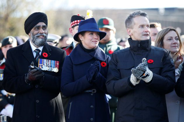 Defence Minister Harjit Sajjan watches a parade with Sophie Gregoire Trudeau and Veterans Affairs Minister...