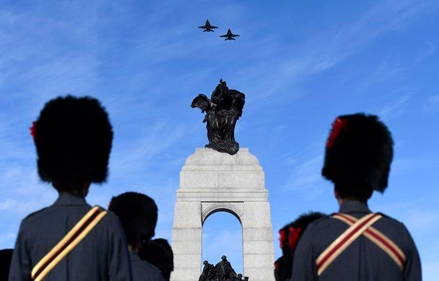 Royal Canadian Air Force CF-18 Hornets fly over the National War Memorial during the National Remembrance...