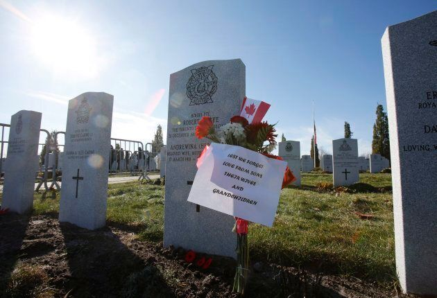 A message is left at the National Military Cemetery during a ceremony on Remembrance Day in