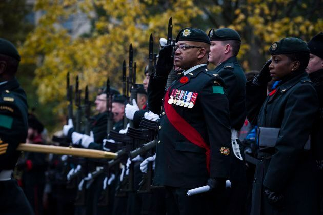 Members of the Canadian Military stand in formation during Remembrance Day service at Queens Park in