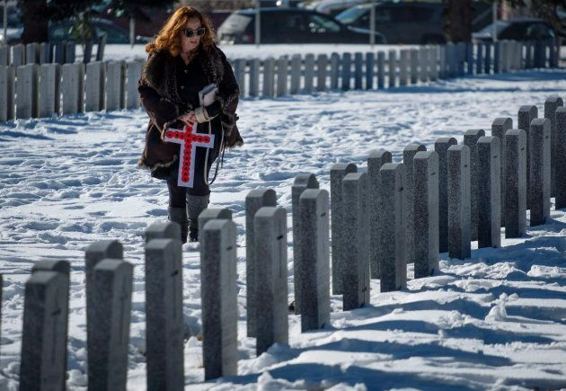 Lyn Moehling looks for the grave marker of her grandfather, WWI veteran Noble Edgar Taggart, following...