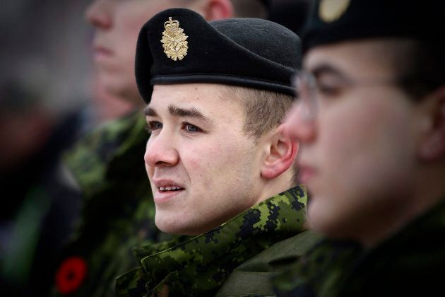 Private Quincy Burrowes with the Royal Winnipeg Rifles stands on vigil guard at a cenotaph during a Remembrance...
