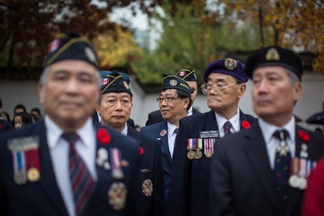 Veterans wait to march during a Remembrance Day ceremony honouring the sacrifices of the early Chinese...