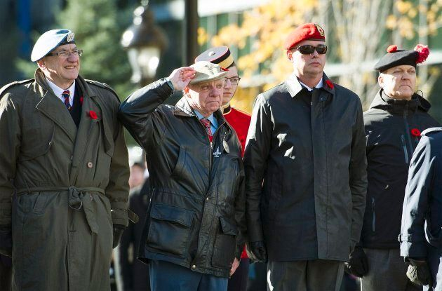 Veterans salute during a Remembrance Day ceremony in