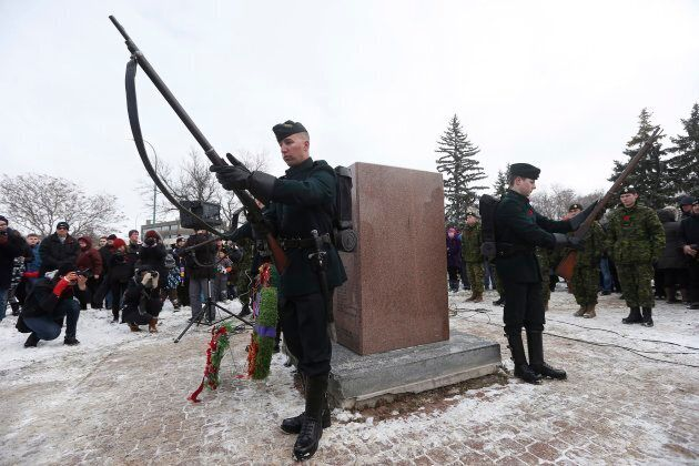 Royal Winnipeg Rifle skirmishers stand vigil guard at a cenotaph during a Remembrance Day service in