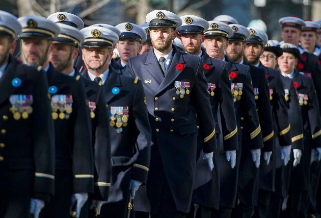 Members of the French Navy march during a Remembrance Day ceremony in
