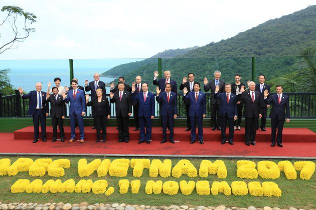 Leaders pose for a group photo at the APEC economic leaders meeting in Danang, Vietnam, November 11,...