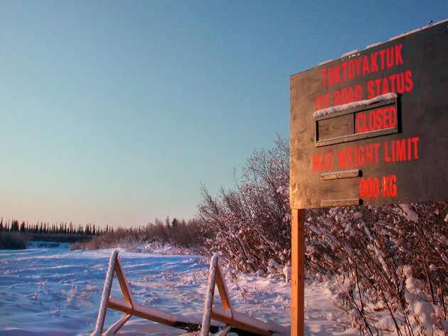 A sign marks the start of the ice road between Inuvik and Tuktoyaktuk, Nov. 11,