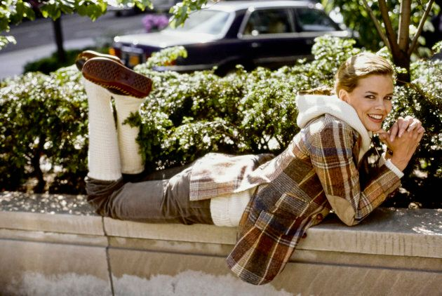 Model Lisa Taylor wearing a Ralph Lauren plaid hooded jacket corduroy jeans and leg warmers.