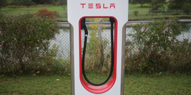 A Tesla electric vehicle charger is seen on a river bank at the edge of a parking lot in Kitchener, Ont.,...