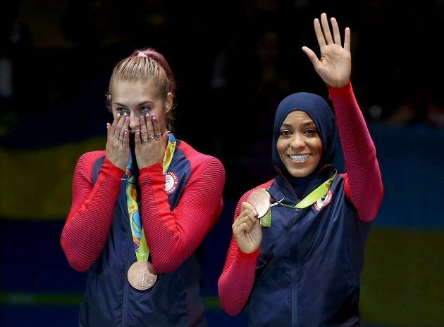 Team U.S.A. member Ibtihaj Muhammad and Dagmara Wozniak celebrate winning the bronze medal at the 2016 Rio Olympics on Aug. 13, 2016.