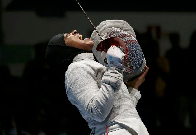 Ibtihaj Muhammad celebrates after advancing to the women's sabre team semifinals at the 2016 Rio Olympics on Aug. 13, 2016.