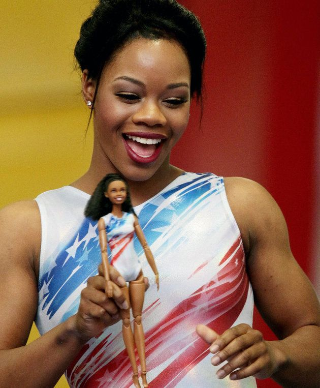 U.S. gymnast gold medallist Gabby Douglas playing with her own Barbie-inspired doll in 2016.