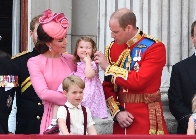 The Duke and Duchess of Cambridge with their children at Buckingham Palace during the annual Trooping...