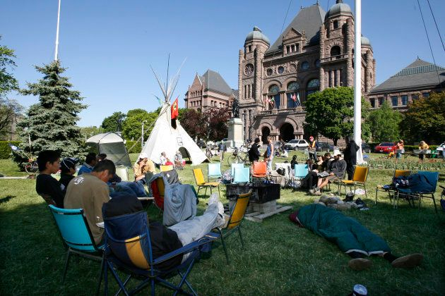 The Kitchenuhmaykoosib Inninuwug, Ardoch Algonquin and Grassy Narrows First Nations gather at Queen's...
