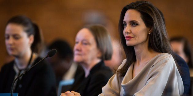UNHCR Special Envoy Angelina Jolie listens to Minister of Foreign Affairs Chrystia Freeland after giving...